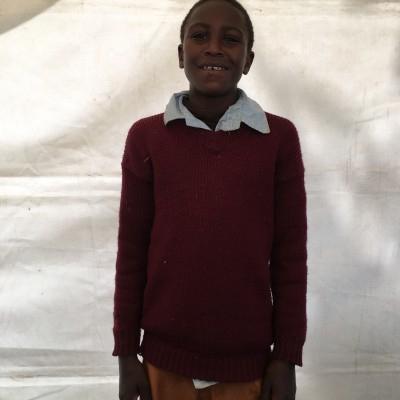 Antony Kinyua, one of the children helped by Eudaimonia through Child Sponsorship Kenya