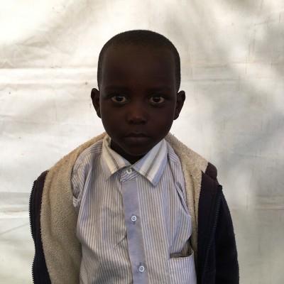 Onesmus Kinoti, one of the children helped by Eudaimonia through Child Sponsorship Kenya